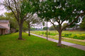 Creek park with track and green lawn grass in texas outdoor Stock Image