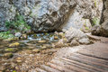 Creek under rocks with wooden footpath in prosiecka valley slovakia Stock Photos