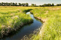 Creek winding through kansas pasture grassy Stock Photography