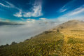Creeping fog in mountain valley at sunset with colorful sky Royalty Free Stock Photo