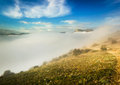 Creeping fog in mountain valley at sunset with colorful sky Royalty Free Stock Images