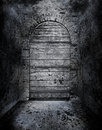 Creepy forbidden door a with no handle or knob in a tomb like corridor concept for a frightening area or halloween Stock Photos