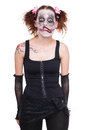 Creepy funny girl with scary makeup looks to the viewer Royalty Free Stock Images