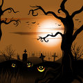 Creepy tree halloween background with full moon and cemetery eps Stock Image