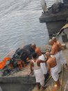Cremation on the bagmati river nepal flows through kathmandu valley in it is considered a holy by hindus and buddhists hindus are Royalty Free Stock Photo