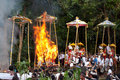 Cremation Ceremony: funeral pyres on fire Stock Image