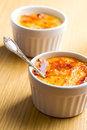 Creme brulee in ceramic bowl Stock Images