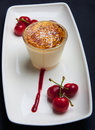 Creme Brulee and Cherries Stock Image