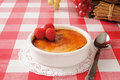Creme brulee with raspberries in white ramekin fresh Stock Image