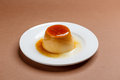 Creme caramel on white plate Royalty Free Stock Photography