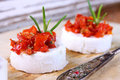 Creme cheese canapes with sun dried tomatoes Royalty Free Stock Photography