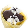 Crepe with chocolate ice cream filled garnished pralines and whipped and provided and styled by Stock Photo