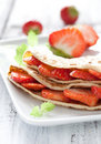 Crepe filled with strawberries Stock Photography