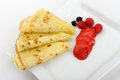 Crepe on a plate with a strawberry Royalty Free Stock Photo