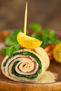 Crepe roll filled with ham and spinach as finger food garnished cherry tomato watercress served on wooden plate selective Royalty Free Stock Image