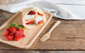 Crepes cake roll cream cheese with fresh strawberry. Royalty Free Stock Photo