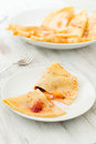 Crepes with fruit peach and icing sugar Royalty Free Stock Photos