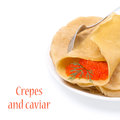 Crepes with red caviar on the plate isolated white Royalty Free Stock Photo