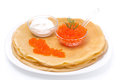 Crepes with red caviar and sour cream isolated on white Royalty Free Stock Image