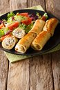 Crepes rolls with chicken, cheese and mushrooms close-up and veg Royalty Free Stock Photo