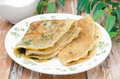 Crepes with spinach on a plate Royalty Free Stock Photography