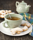 Crescents vanilla and almond cookies and cup of green tea on table Royalty Free Stock Photos