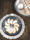 Crescents vanilla and almond cookies on plate Stock Photos