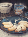 Crescents vanilla and almond cookies on table Royalty Free Stock Photos