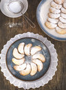 Crescents vanilla and almond cookies on wooden table Stock Photography