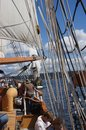 The crew rigs the sails of the hawaiian chieftain kirkland washington aug as she on lake washington during a mock sea battle Royalty Free Stock Images