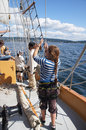 The crew rigs the sails kirkland washington aug of hawaiian chieftain as she on lake washington during a mock sea battle Stock Images