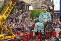 Crew of Royal de Luxe theatre controlling giant mechanical doll