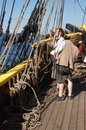 The crew sets the sails of the Lady Washington Stock Photography