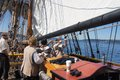The crew sets the sails of the lady washington kirkland sep as she on lake during a mock sea battle as Royalty Free Stock Photography