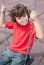 Criança feliz no balanço Fotografia de Stock