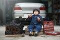 image photo : Little child repairing car engine