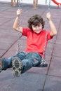 Criança feliz no balanço Imagem de Stock Royalty Free