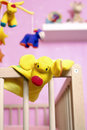 Crib with toys focus on foreground Royalty Free Stock Photography
