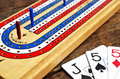 Cribbage board and playing cards Royalty Free Stock Photo