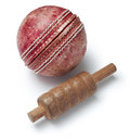 Cricket ball an old with one bail on a white background Royalty Free Stock Image