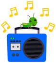 Cricket s music a on top of a radio and listening to Royalty Free Stock Photography