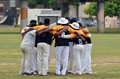 Cricket team pre game huddle Royalty Free Stock Photo