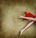 Crime scene imitation. Woman found lying in a pool of blood Stock Photography