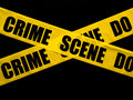 Crime scene tape crossed on black Royalty Free Stock Photography