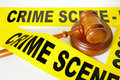 Crime scene tape and gavel Stock Photography