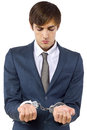 Crime young caucasian male arrested for tax evasion Stock Image