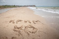 Crimea is ukraine sign on the sand ua in ukrainian and ua as international abbreviation for beach by seaside in Royalty Free Stock Images