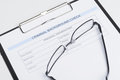 Criminal background check document close up of criminal backgro with a eyeglasses lying on it Royalty Free Stock Photo