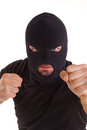 Criminal with balaclava pull any punches on white background Stock Photo