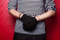 Criminal hands locked in handcuffs close up view on red background Royalty Free Stock Photos